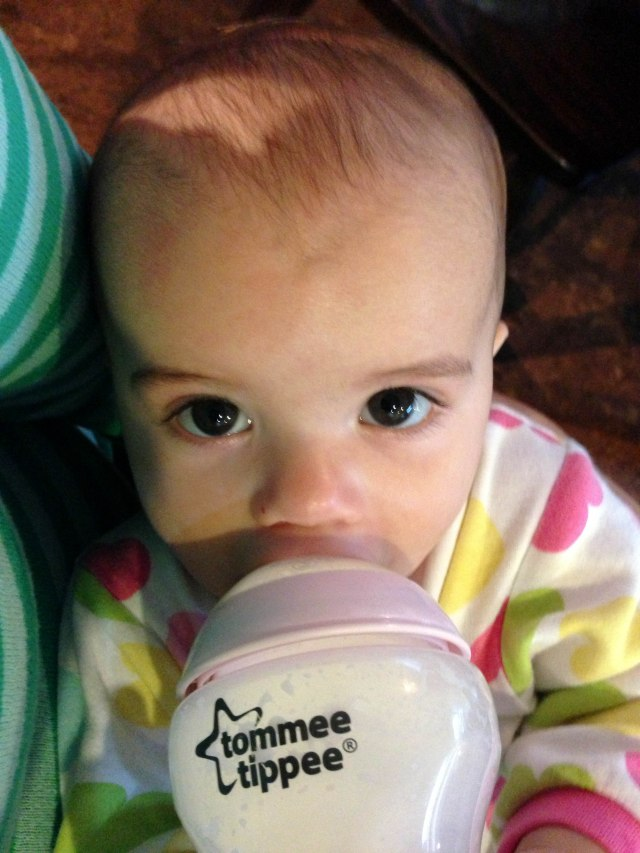 Having your pre-nap bottle. For an outsider, you might look ok, but I can tell you're under the weather just looking at your eyes. :(
