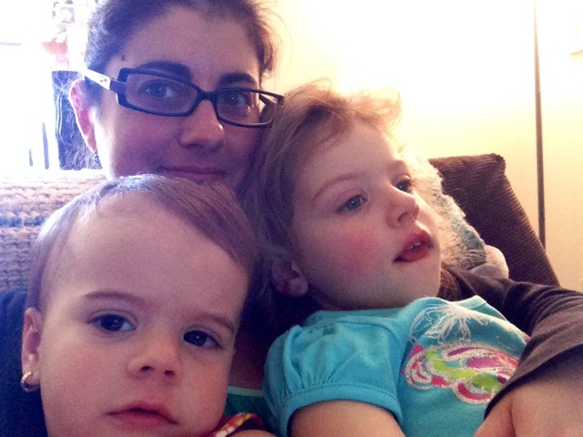 Watching Curious George with the sickies. Everybody looks tired, myself included! ;)
