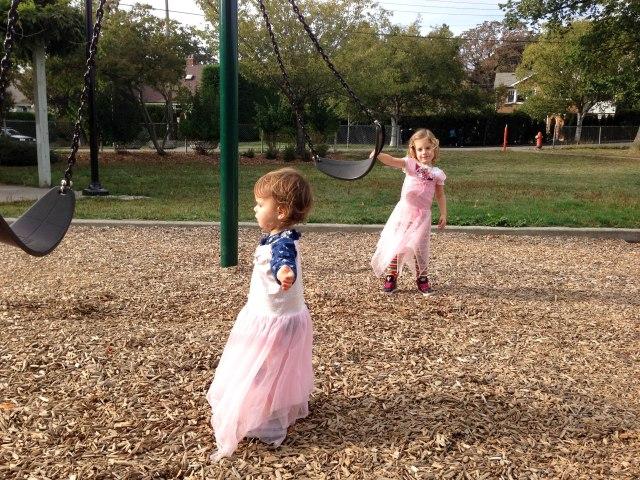 Pushing their swings!