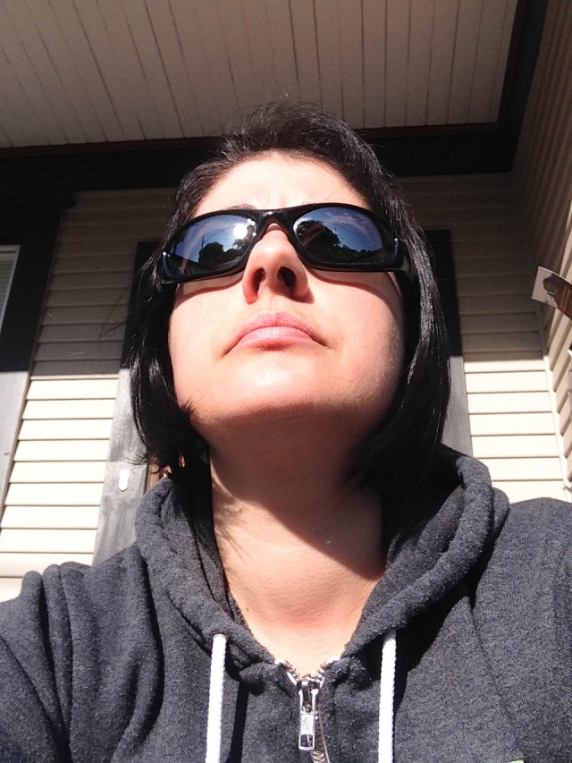 All thug-like (actually enjoying 30 secs of peace in the sun)