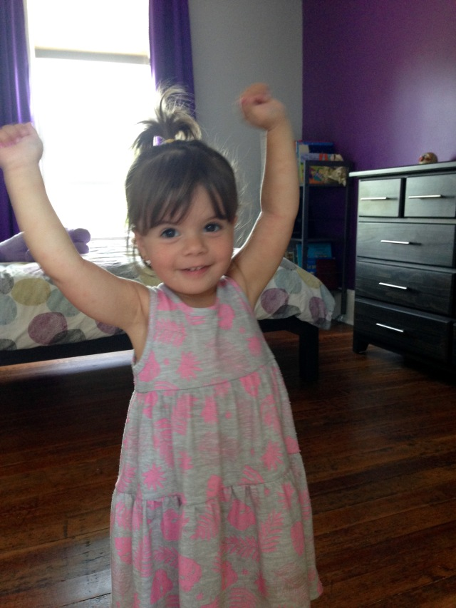 Béa, showing me her muscles and her ponytail!