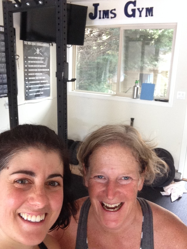 Mandatory selfie and Kathleen and I with Jim's Gym sign in the background!